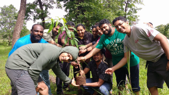 Pit viper expedition team planting a tree.